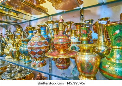 The masterpiece brass jugs, coffee pots, vases and tea sets, decorated in Meenakari technique, that includes scrollwork, fine floral patterns, engravings and colorful enamels, Shiraz, Iran