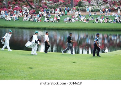 Masters.  Golfers and Caddies at Augusta