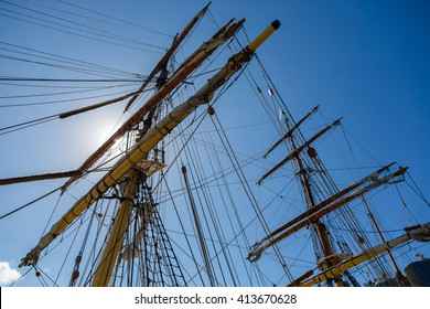 Masting of big wooden sailing ship, detailed rigging without sails