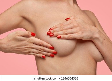 Mastitis, fibrocystic or breast cancer. Woman has serious disease and inflammation of mammary glands, being examined by doctor. Unrecognizable patient prepares for plastic surgery on breast.