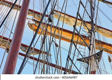 Masts of big wooden sailing ships, detailed rigging without sails
