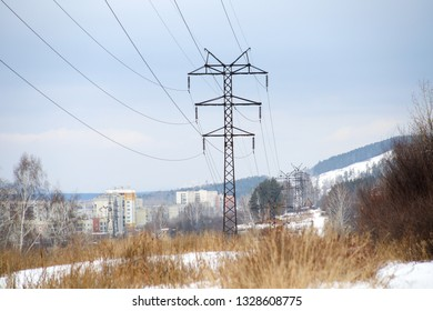 masts of old electricity transmission line to the city