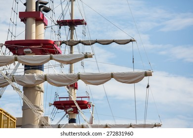 Masts, rigging and the sail of a pirate ship with the blue sky
