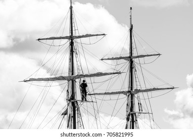 Masts of a sailing vessel. Black and white photo.