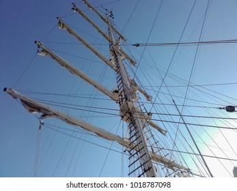 Masts of ship sailboat with folded sails occupying the whole setting in horizontal