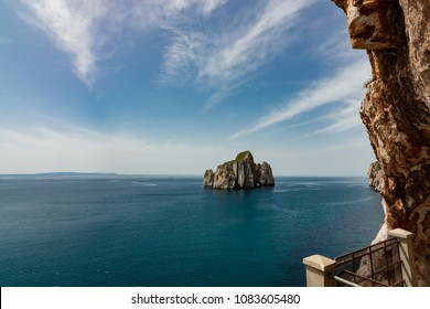 Masua, Sardinia, Italy - April 25 2018: Seaside view of Pan di Zucchero and sea stacks of Masua from Porto Flavia minery