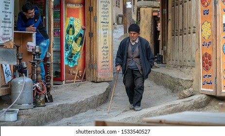 Masuleh, Iran - May 2019: Iranian old man walking in the narrow road of Masuleh village