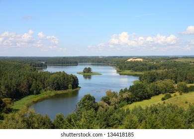 Masuria (Mazury) - famous lake district in Poland. Summer landscape in Europe. Jedzelewo lake in Stare Juchy.
