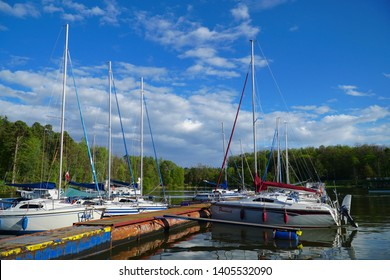 Masuria, Poland - 3 May 2019: Masuria is a region in northern Poland, famous for its 2,000 lakes. Yachts moored by the jetty.
