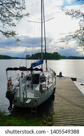 Masuria, Poland - 3 May 2019: Masuria is a region in northern Poland, famous for its 2,000 lakes. Yacht moored by the jetty.