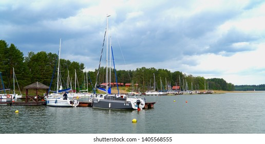 Masuria, Poland - 4 May 2019: Masuria is a region in northern Poland, famous for its 2,000 lakes. Yachts moored by the jetty.