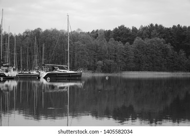 Masuria, Poland - 4 May 2019: Black and white photography. Yachts moored by the jetty. Masuria is a region in northern Poland, famous for its 2,000 lakes.