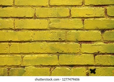 Mat brick wall paint in pastel yellow