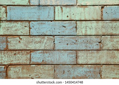 Mat brick wall paint in pastel green and pale blue