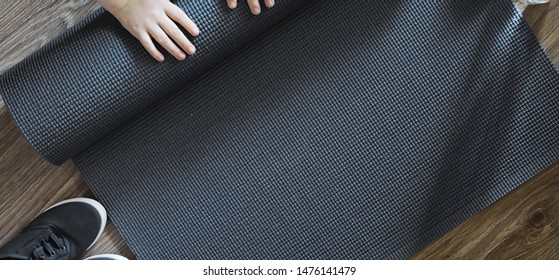 Mat for practicing yoga on a floor. Healthy lifestyle.