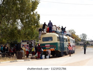 Matabeleland, Zimbabwe. June 26th 2018. Passengers prepare to board rural buses in the Marula and Plumtree area of Zimbabwe. African solutions to excess baggage.