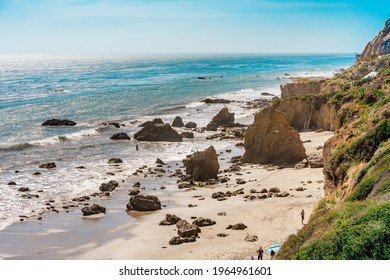 Matador beach and beautiful landscape with rocks and ocean against blue sky, California