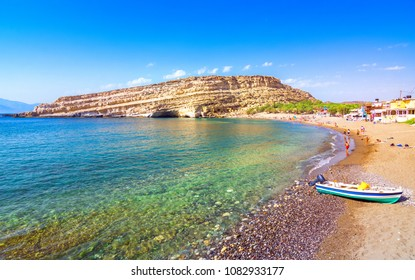 Matala beach with caves on the rocks that were used as a roman cemetery and at the decade of 70's were living hippies from all over the world, Crete, Greece