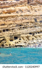 Matala beach with caves on the rocks that were used as a roman cemetery and at the decade of 70's were living hippies from all over the world, Crete, Greece on June  21, 2018