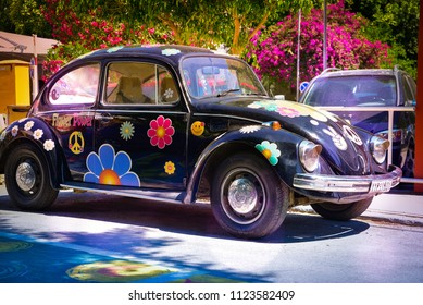 Matala , Greece - June 14, 2018 : Volkswagen beetle in Matala village became famous in the '60s  '70s when youngsters  traveling the 'hippie trail' overland from London to India and stop at Matala,