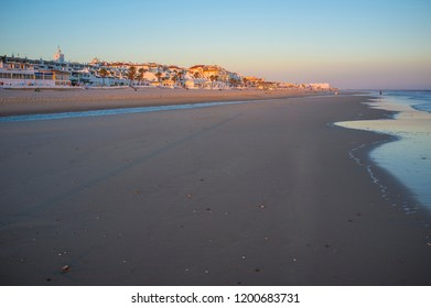Matalascanas town from beach at Sunset. Costa de la Luz seashore, Huelva, Spain