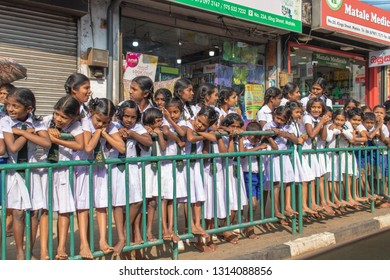 Matale, Sri Lanka - January 28, 2019: Schoolgirls in white clothes during the Day Perahera, the event of the Buddhist Esala Perahera