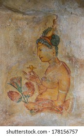 MATALE, SRI LANKA- JANUARY 28, 2014: Frescoe of the woman at Sigiriya Rock Fortress at Matale. Sigiriya today is a UNESCO listed World Heritage Site and most visited historic site in Sri Lanka.