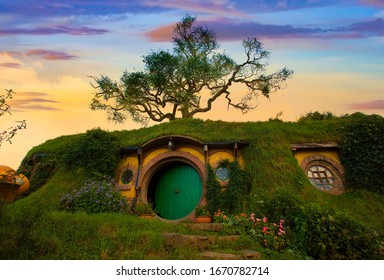 """MATAMATA- NEW ZEALAND -APRIL -19- 2019 : Hobbiton movie set created for filming the Lord of the Rings and """"Hobbit"""" movies at Matamata, New Zealand,evening scene with twilight sky image"""