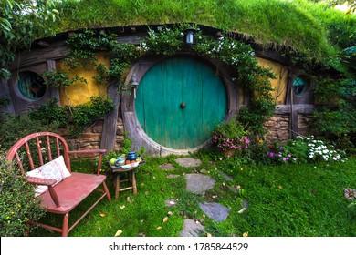 MATAMATA- NEW ZEALAND -APRIL -19- 2019 :Hobbit houses at river in Hobbiton, New Zealand ,which Hobbiton house with Green door and Movie set Lord of the rings