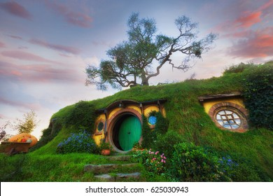 "MATAMATA- NEW ZEALAND -APRIL -19- 2017 : Hobbiton - movie set created for filming the Lord of the Rings and ""Hobbit"" movies - Matamata, New Zealand,evening scene with twilight sky image"
