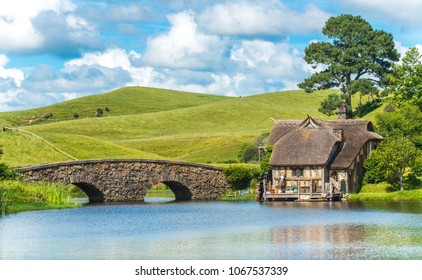 Matamata, New Zealand - December 09 2017 : The scenery view of Hobbiton mill and double-arched bridge at the Hobbiton movie set in Alexander Farm, New Zealand.