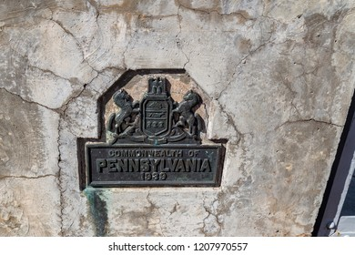 Matamoras, PA, USA - October 17, 2018:  A small Pennsylvania marker on the Mid-Delaware Bridge that carries U.S. Routes 6 and 209 across the river between New York and Pennsylvania.