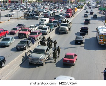 Matamoros, Tamaulipas, Mexico - September 30, 2010: Mexican Navy convoy aproaching a road block with infantry on foot ready for combat