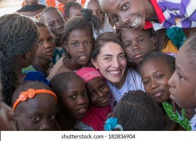 MATAM,SENEGAL-CIRCA NOVEMBER 2013:Actress Caterina Murino greets the children of an elementary school,Caterina Murino is the testimonial of the NGO AMREF,circa November 2013.