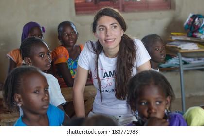 MATAM,SENEGAL-CIRCA NOVEMBER 2013:Actress Caterina Murino speaks with the children of an elementary school,Caterina Murino is the testimonial of the NGO AMREF,circa November 2013.