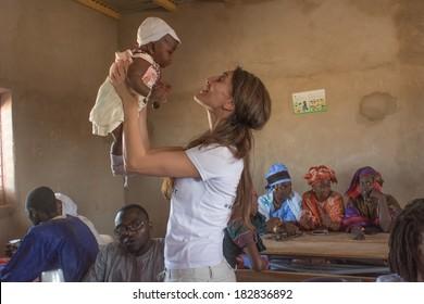 MATAM,SENEGAL-CIRCA NOVEMBER 2013:Caterina Murino plays with an African child,Caterina Murino is the testimonial of the NGO AMREF,circa November 2013.