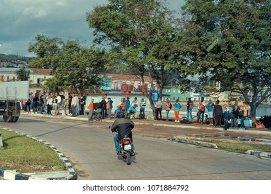 MATANZAS, CUBA - January 4, 2018: People on the road waiting for a public transport vehicle.