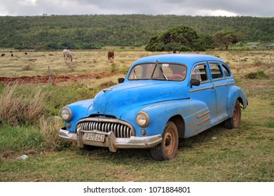 MATANZAS, CUBA - January 4, 2018 - Vintage classic car parked at the grassland.