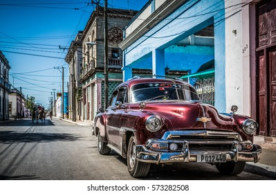 MATANZAS, CUBA - JUNE 27, 2015: HDR - Streetlife view with a wine red american Chevrolet classic car on the street in Matanzas Cuba - Serie Cuba Reportage