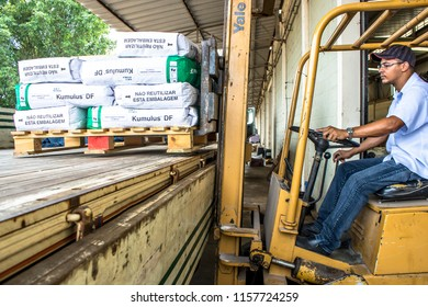 Matao, Sao Paulo, Brazil, February 19, 2013. Employee works with a forklift to organize the warehouse and load a truck with agricultural inputs in Sao Paulo State