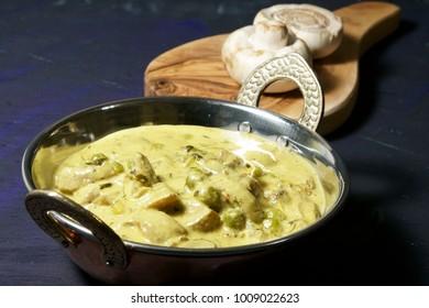 Matar Mushroom malai with fenugreek leaves, a creamy Indian Mushroom curry.