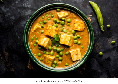 matar paneer curry recipe made using cottage cheese with green peas, served in a bowl. selective focus