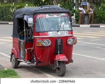 MATARA, SRI LANKA - NOVEMBER 5, 2014: Auto rickshaw or tuk-tuk on the street of Matara. Most tuk-tuks in Sri Lanka are a slightly modified Indian Bajaj model, imported from India.