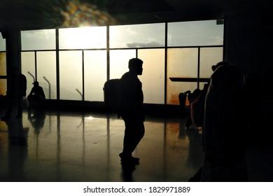 Mataram, Nusa Tenggara Barat / ID - 03/29/2018: Silhouette of airport passengers in the afternoon
