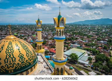 Mataram's National Islamic Centre Mosque looking over the city towards the mountains in Lombok, Indonesia
