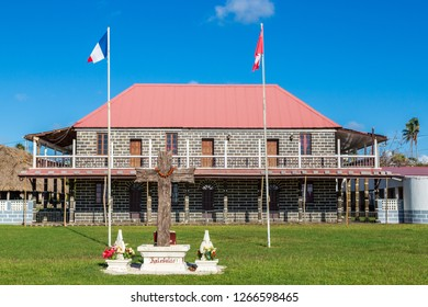 Mata-Utu, Wallis and Futuna - Jan 5 2013: Customary King's Palace in the capital of territory of Wallis et Futuna, French overseas island collectivity. Two flags flying - French and Wallis and Futunes