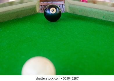 Match ball. Black eight ball to the pocket