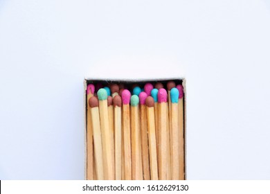A match box with bright colorful matches on a white background.