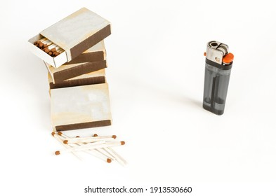 match boxes and lighter on a white background kopi space alternative choice matches and lighter - Shutterstock ID 1913530660