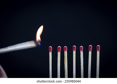 Match Ignition/ A row of match heads being ignited